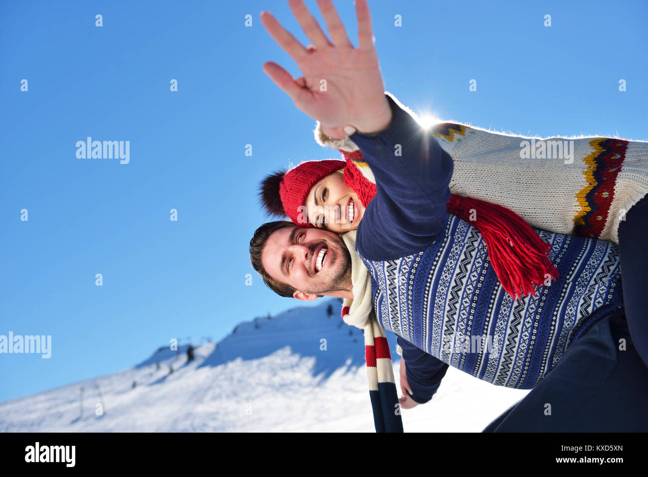 Loving couple playing together in snow outdoor. - Stock Image