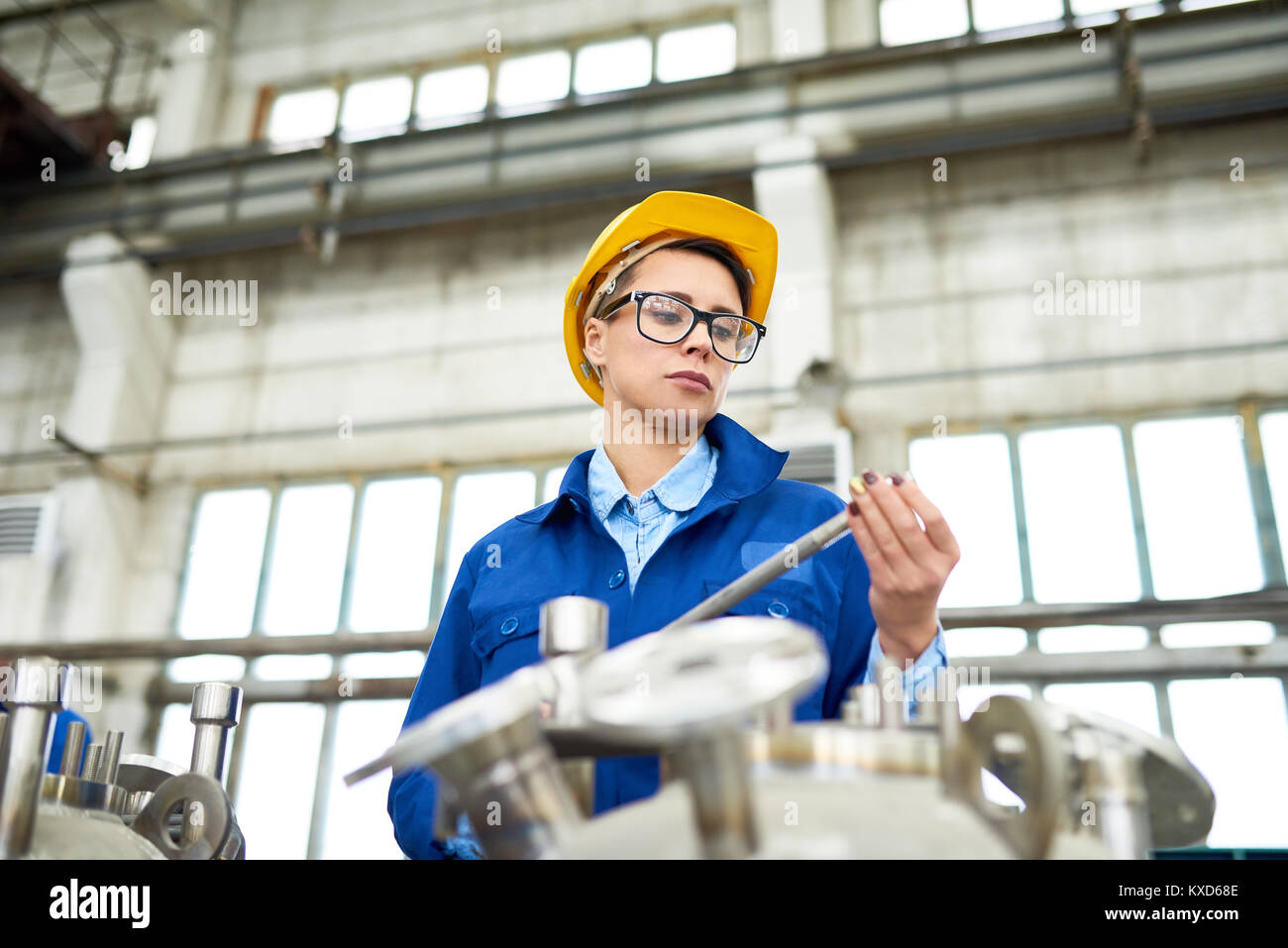 Modern Young Woman Working at Plant Stock Photo