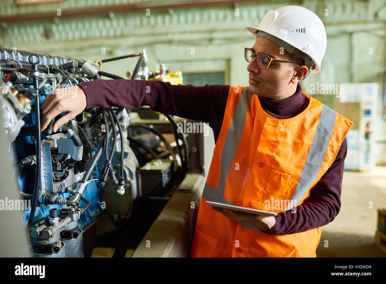 Handsome Technician Adjusting Engine Features - Stock Image