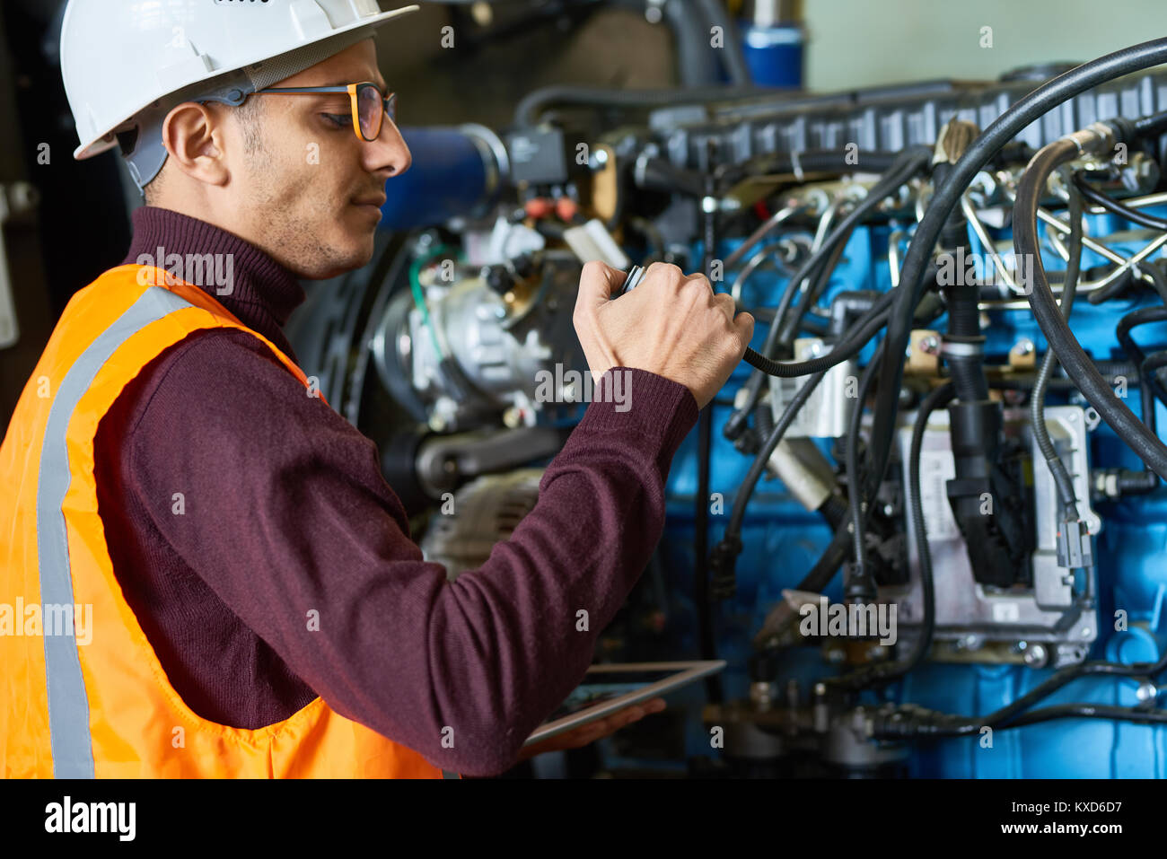 Checking Heavy Equipment at Modern Plant - Stock Image