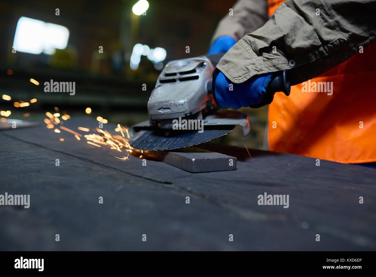 Steel Plant Worker Using Angle Grinder - Stock Image