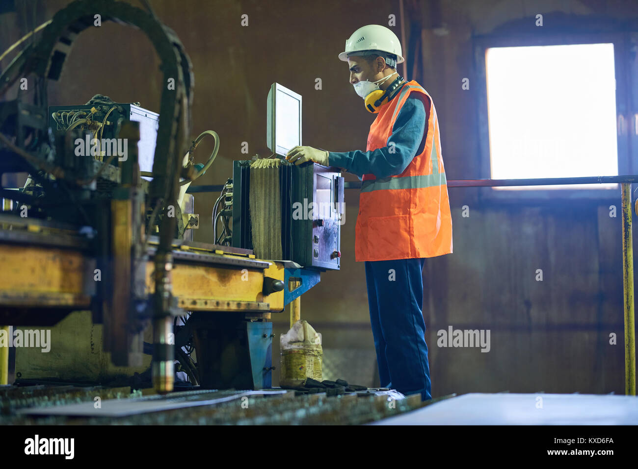 Machine Operator Concentrated on Work - Stock Image