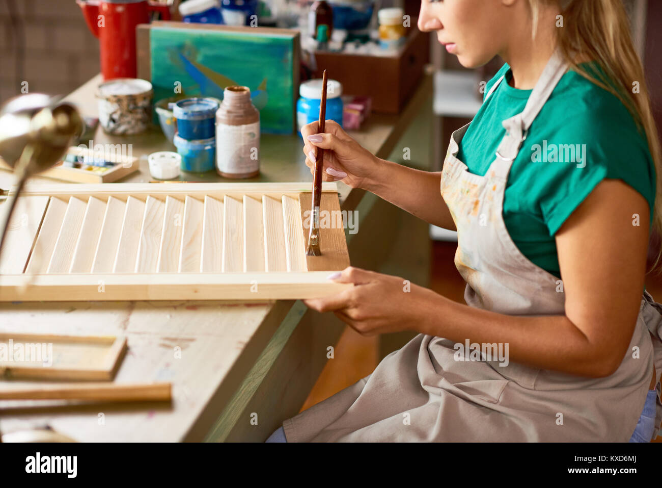 Young Woman Enjoying Crafting in Studio - Stock Image
