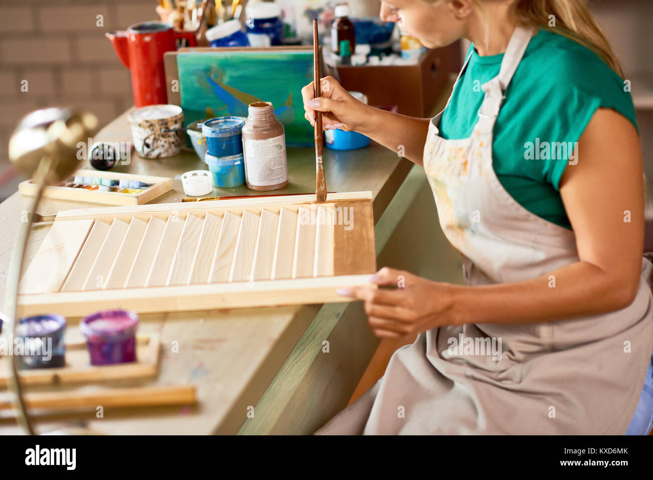 Young Artist Crafting in Studio - Stock Image