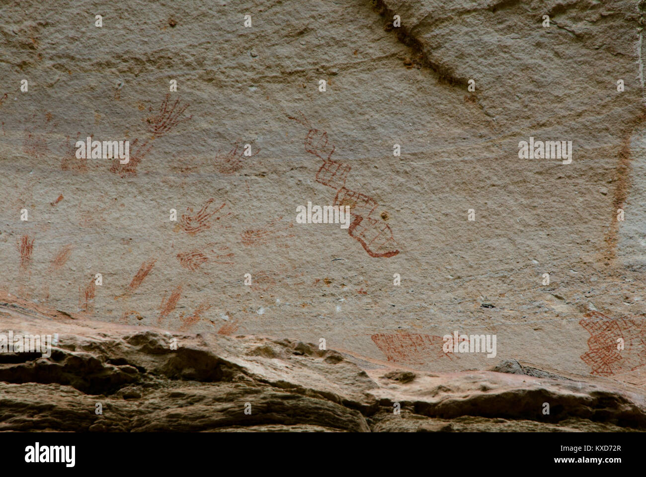 Prehistoric art paintings at cliff of Pha Taem, Ubon Rajchathani, Thailand - Stock Image