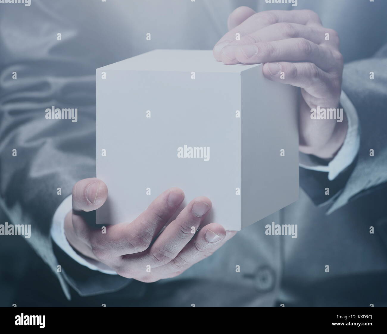 Cube in the male hands - Stock Image