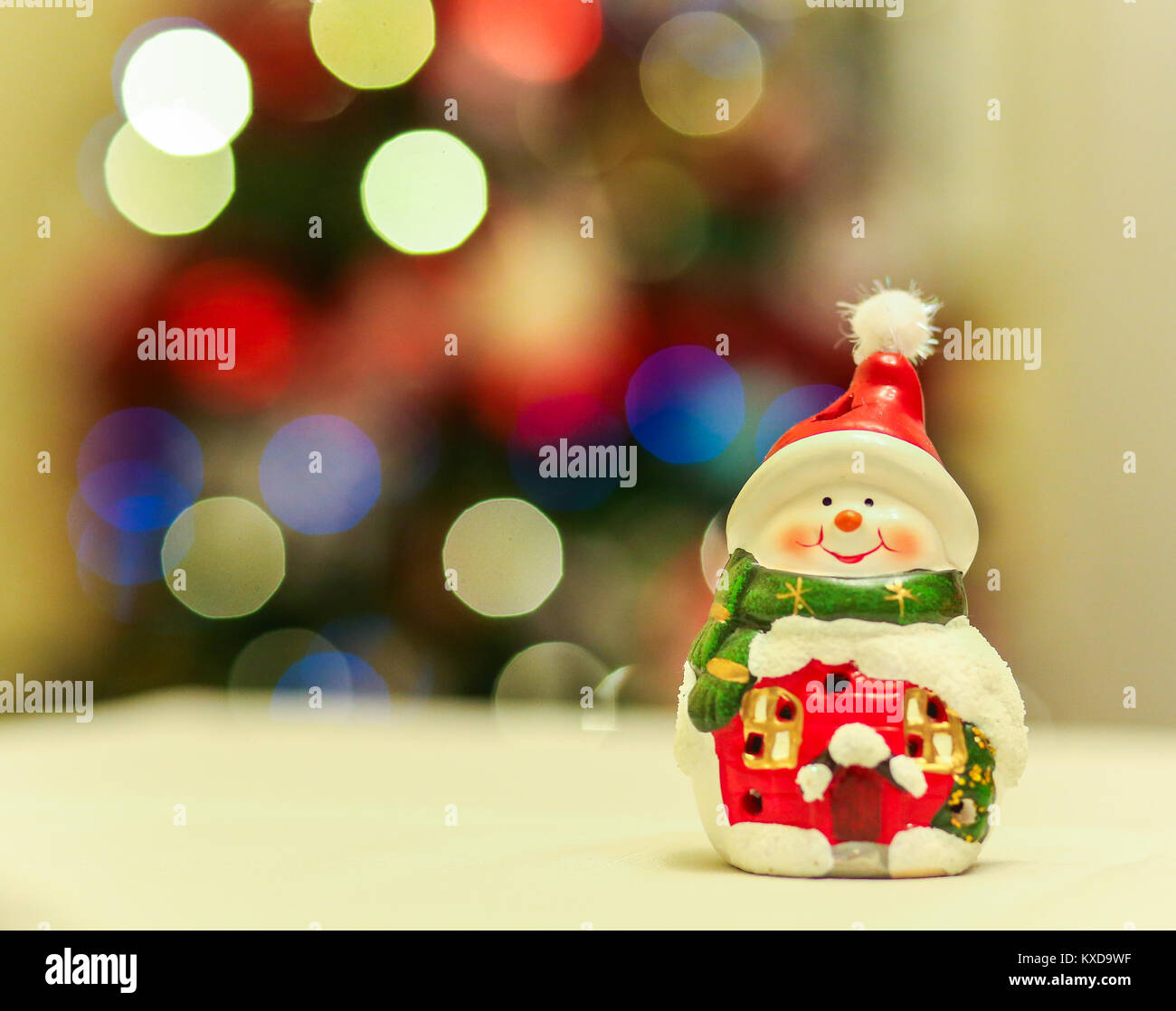 Ceramic Snowman Decoration With Beautiful Bokeh With Christmas Tree