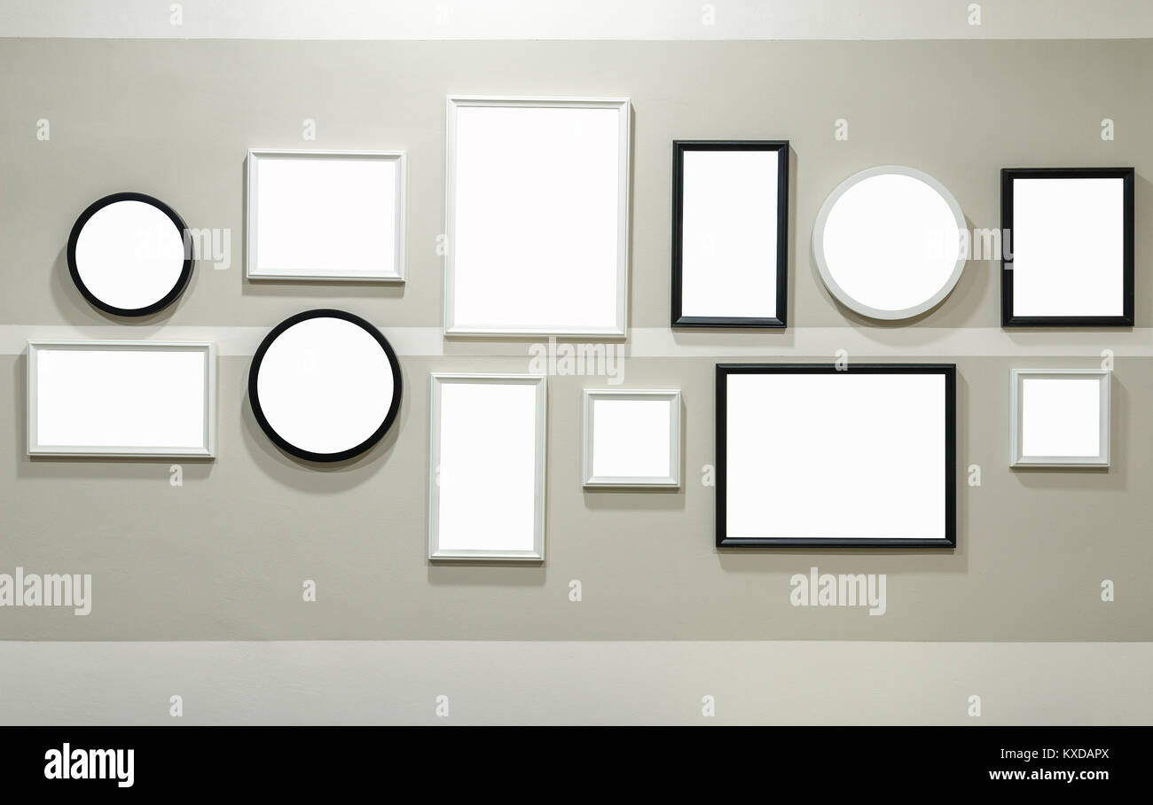 Different size of black and white photo frame on wall - Stock Image