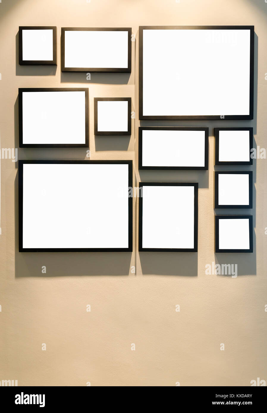 Different size of black photo frame on wall - Stock Image