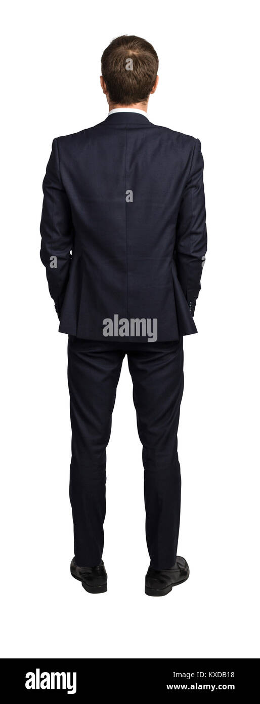 standing businessman back view isolated on white background - Stock Image