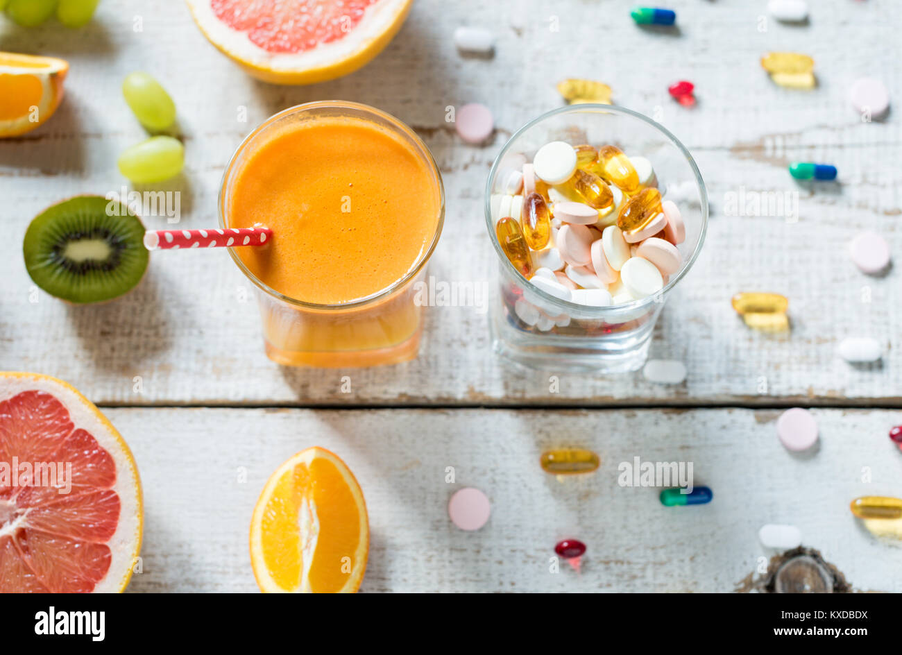 Healthy lifestyle and diet concept  Fruit, pills and vitamin Stock
