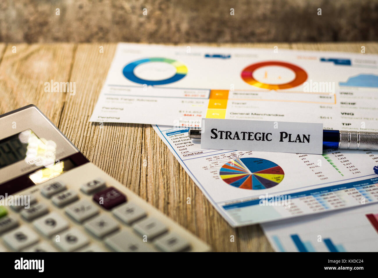 Strategic Plan business finance concept with charts and graphs on wooden board - Stock Image