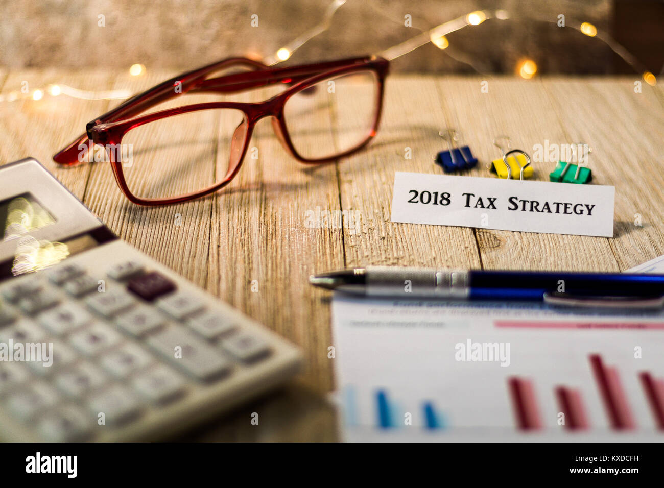 2018 Tax Strategy finance concept with charts and graphs and calculator on wooden board - Stock Image