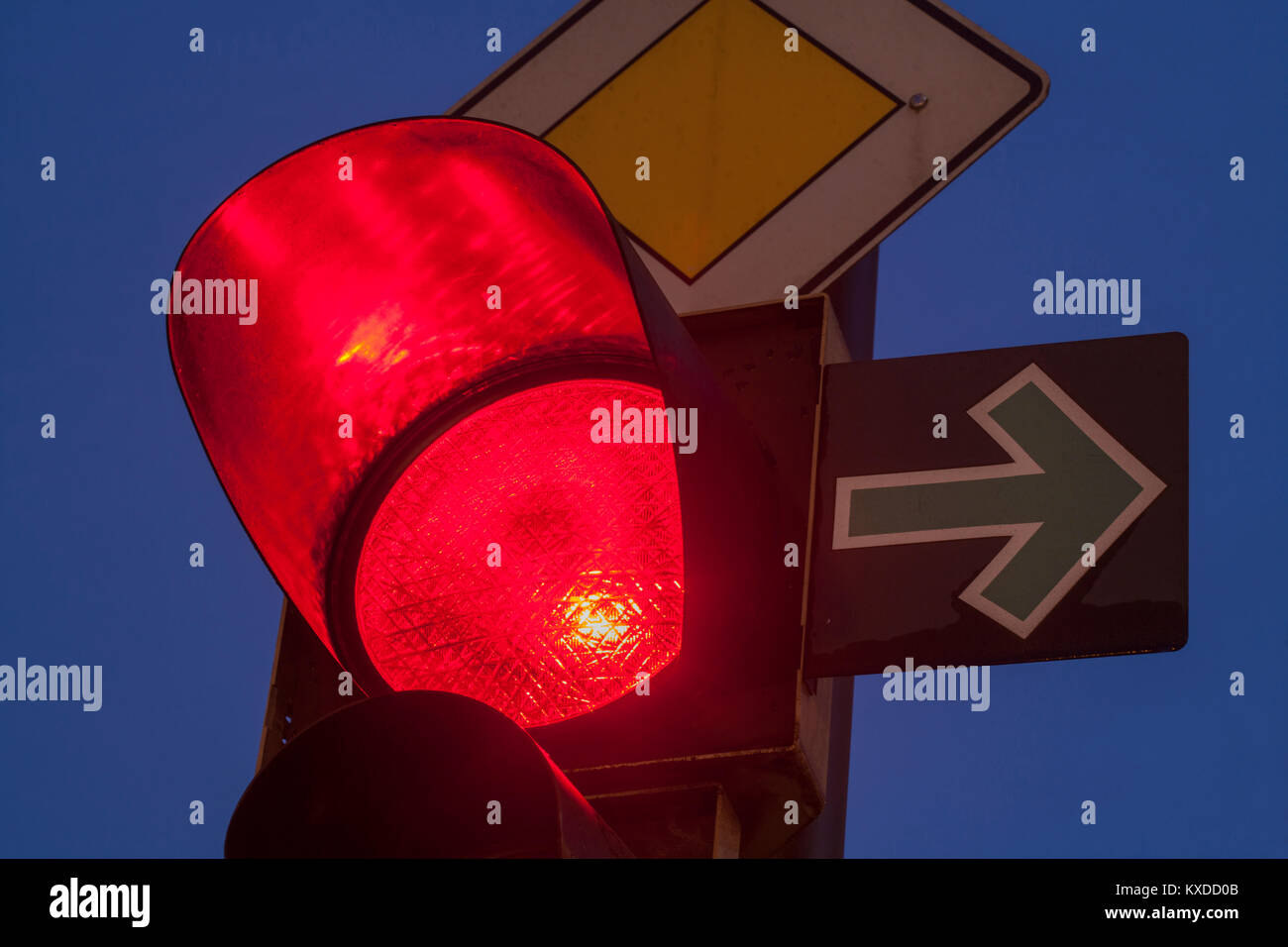 Traffic lights,red,green arrow to the right,twilight,Bremen,Germany - Stock Image
