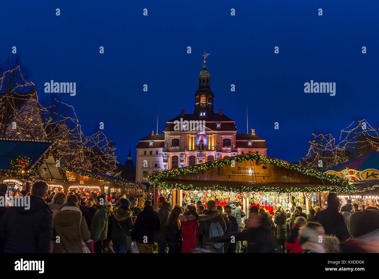 Town hall with Christmas market,colorful illuminated around Christmas time,Lüneburg,Lower Saxony,Germany Stock Photo
