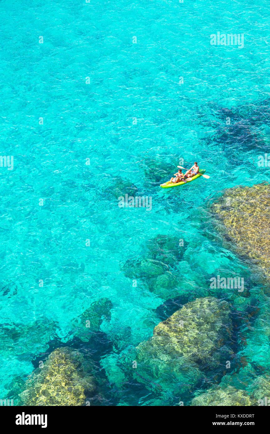 People canoeing at Cala Mitjana,Menorca,Balearic Islands,Spain - Stock Image
