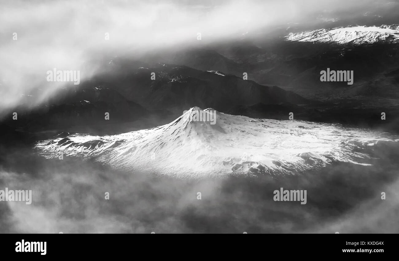 Black and white aerial picture of the snow capped mountains, Chile. - Stock Image