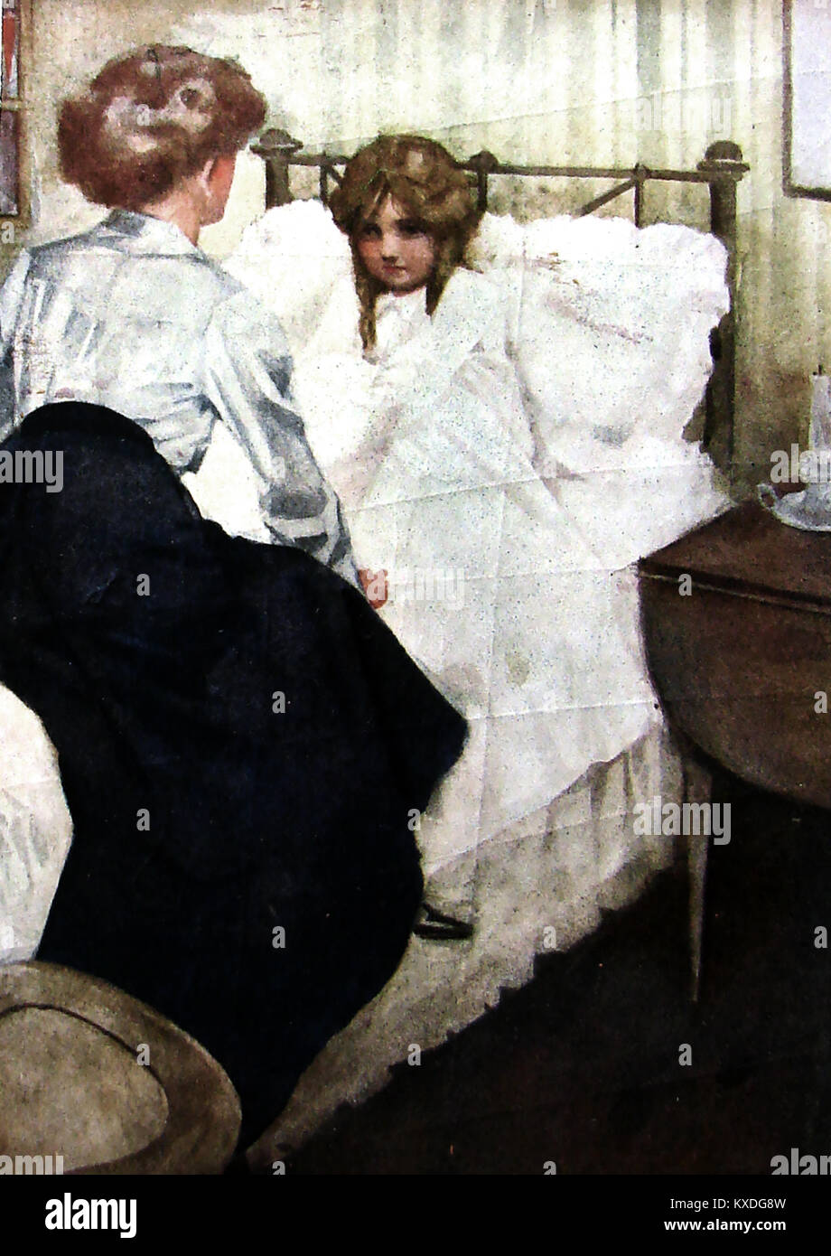 1940s - a child going to bed with her mother in typical fashionable clothes of the time, sitting on the bed - Stock Image