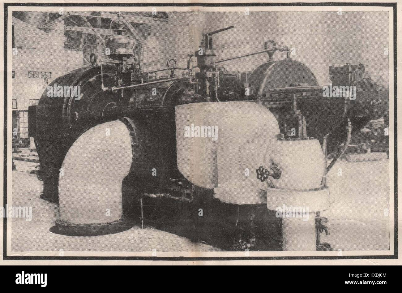 Parsons Turbine in the Machinery building connected to 400-K.W. Generator. Speed 3,600 revolutions per minute - Stock Image