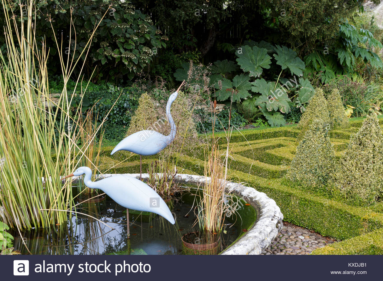 Bourton House Garden, autumn, The formal knot garden with 'Basket' pond - Stock Image