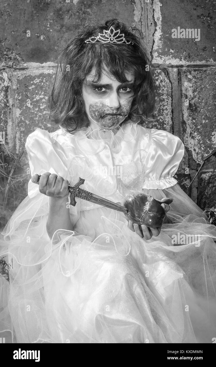 Zombie child with knife - Stock Image