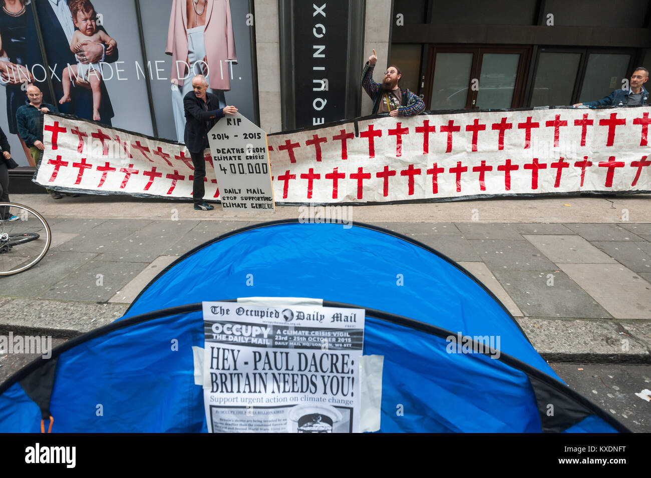 Protesters hold a tombstone and banner with crosses at the 48 hour protest by Occupy aimed at getting the Daily Stock Photo