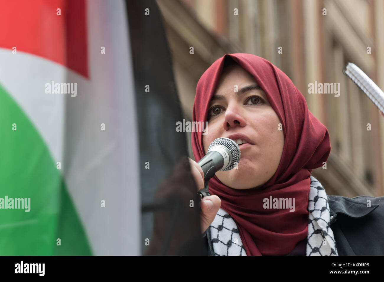 Raghad Altikriti of the  Muslim Association of Britain speaks at protest at Israeli embassy in London calling for - Stock Image