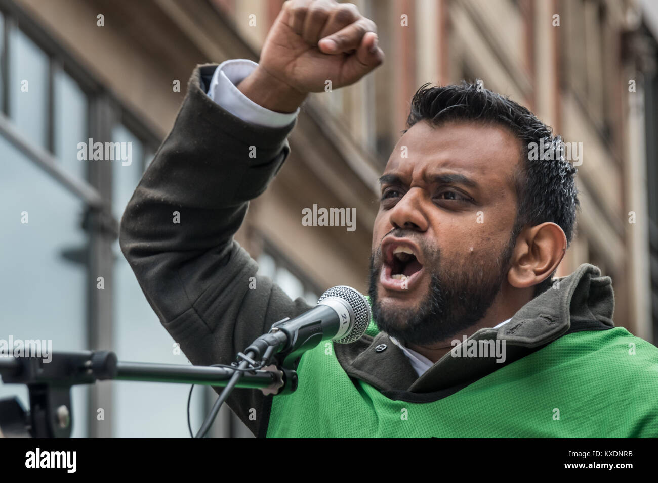 Shamiul Joarder of Friends of Al-Aqsa speaking at protest at Israeli embassy in London calleing for an end to Israeli - Stock Image