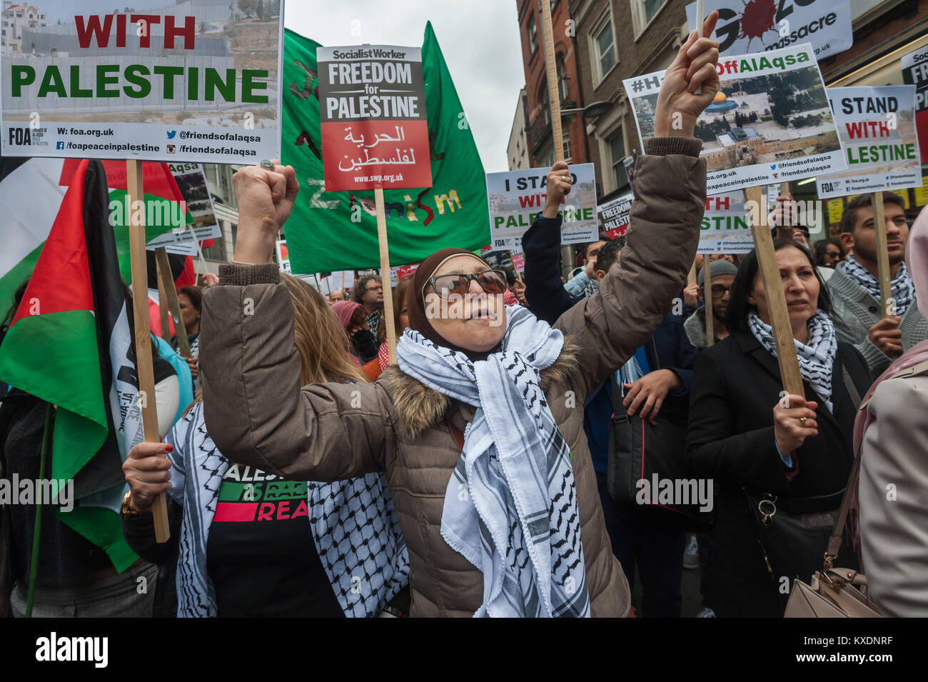 A woman waves her fist at the protest at Israeli embassy in London calleing for an end to Israeli occupation and - Stock Image