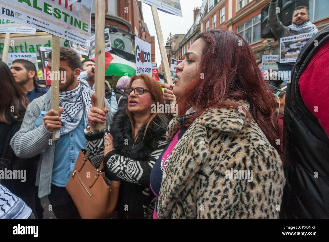 People with placards in the crowd at the protest at Israeli embassy in London calling for an end to Israeli occupation - Stock Image