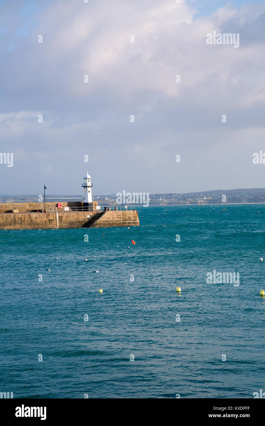 St Ives Cornwall. Vertical image of the lighthouse on Smeaton's Pier at St Ives Cornwall. Stock Photo