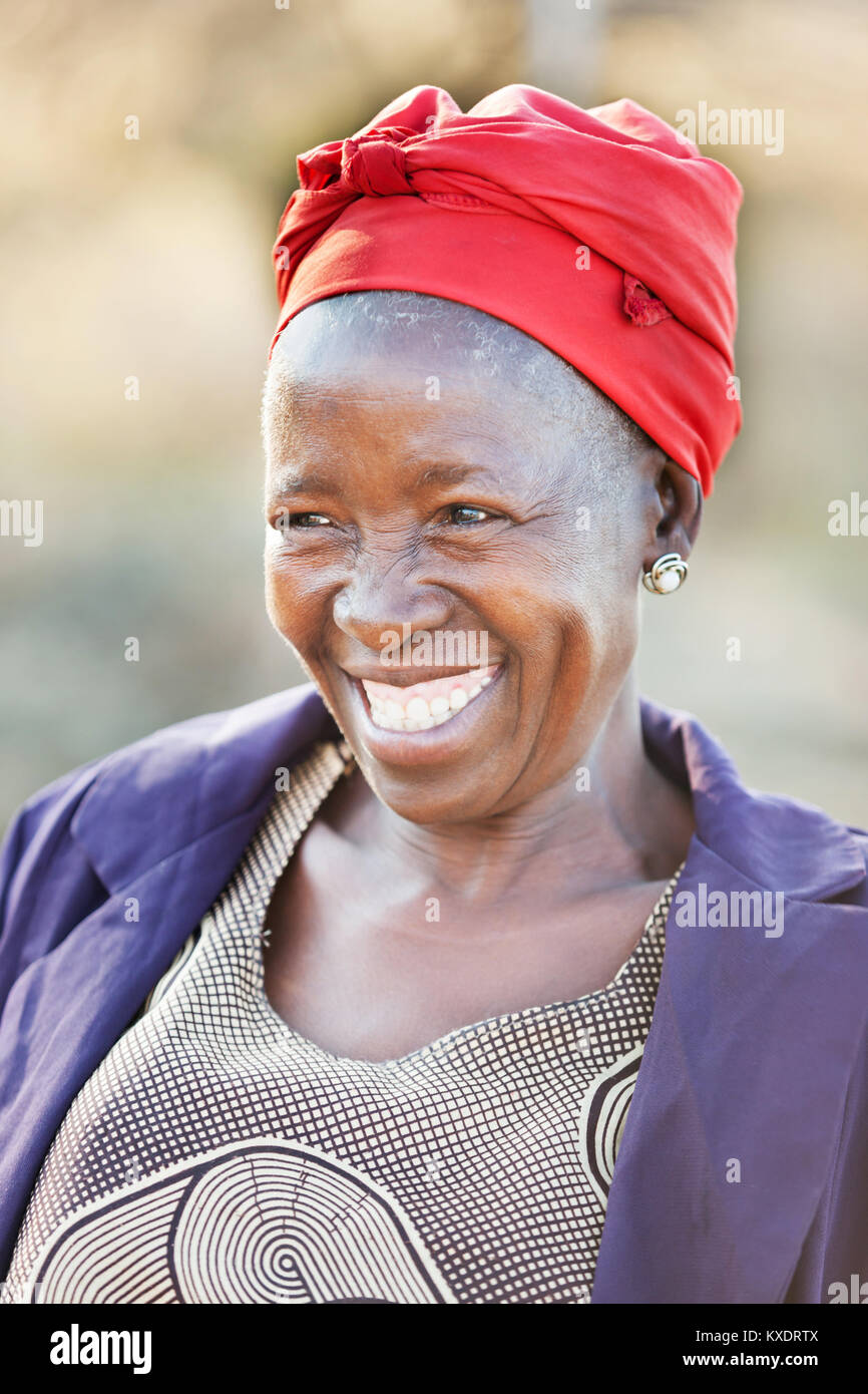 African senior citizen woman in her 70 with a happy face - Stock Image