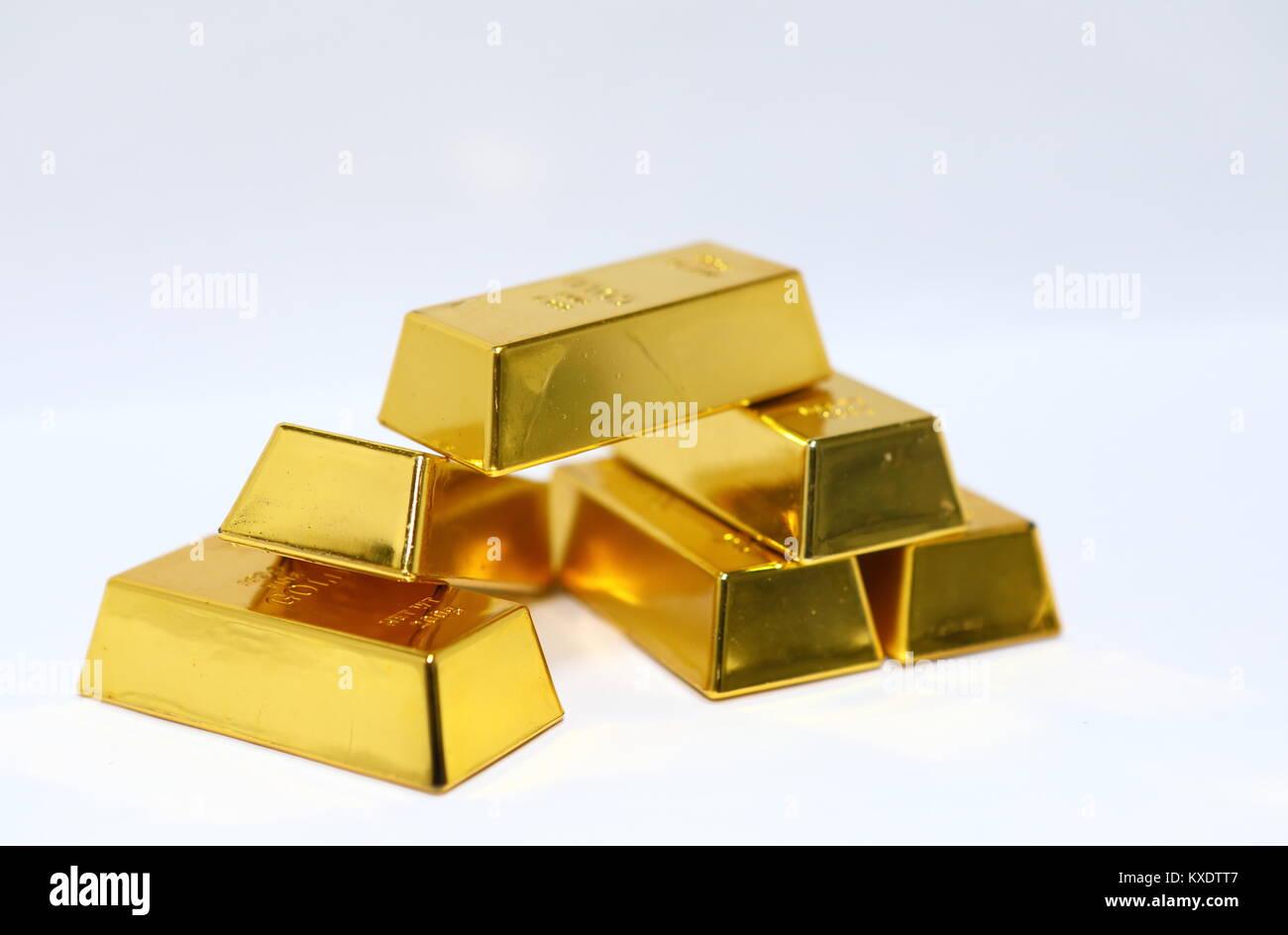 Gold bar ingot pile isolated - Stock Image