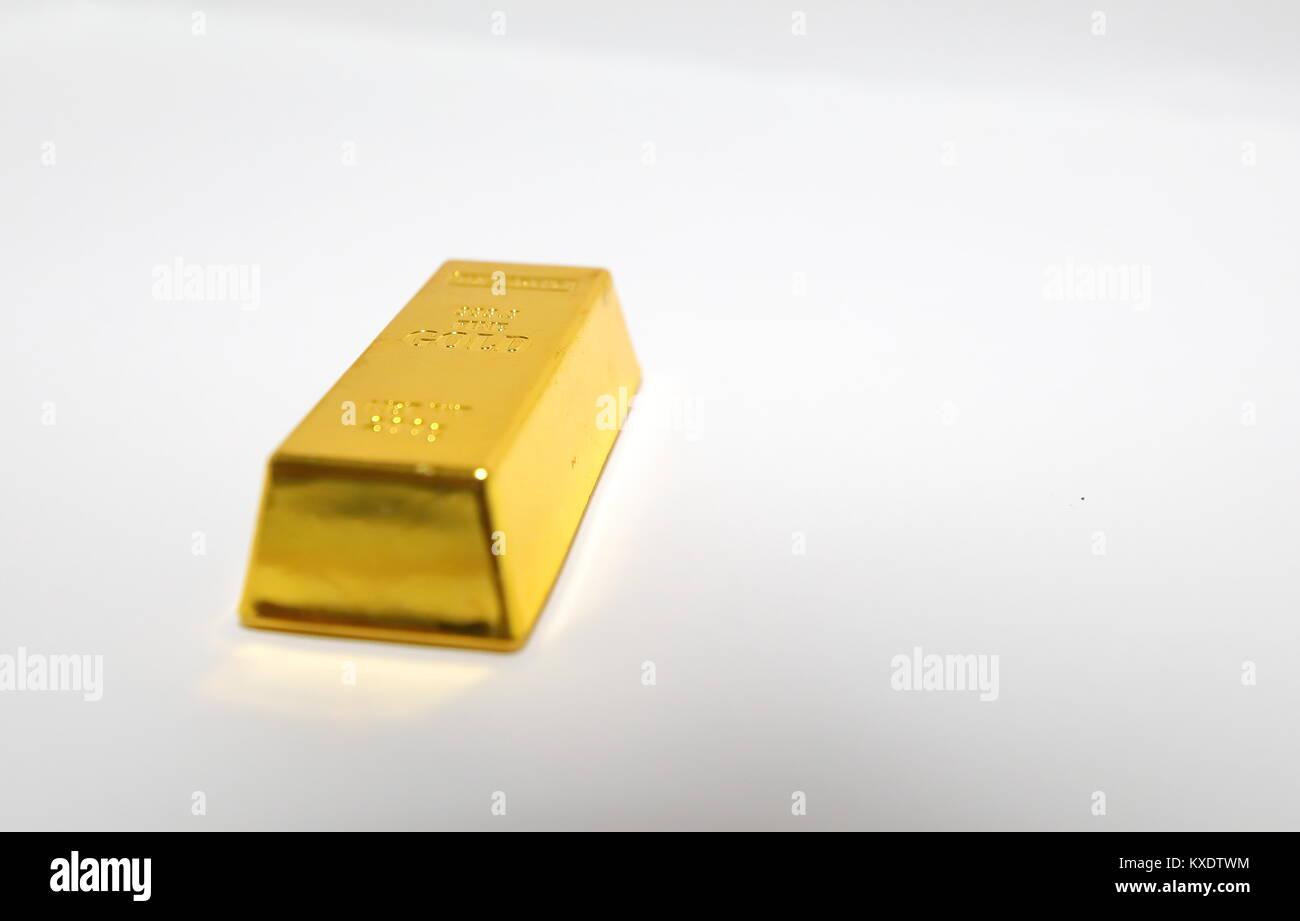 One gold bar ingot isolated - Stock Image