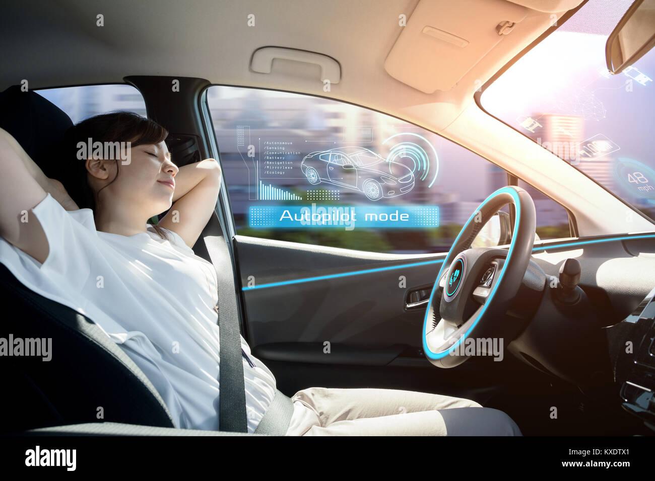 relaxed woman in autonomous car. self driving vehicle. autopilot. automotive technology. - Stock Image