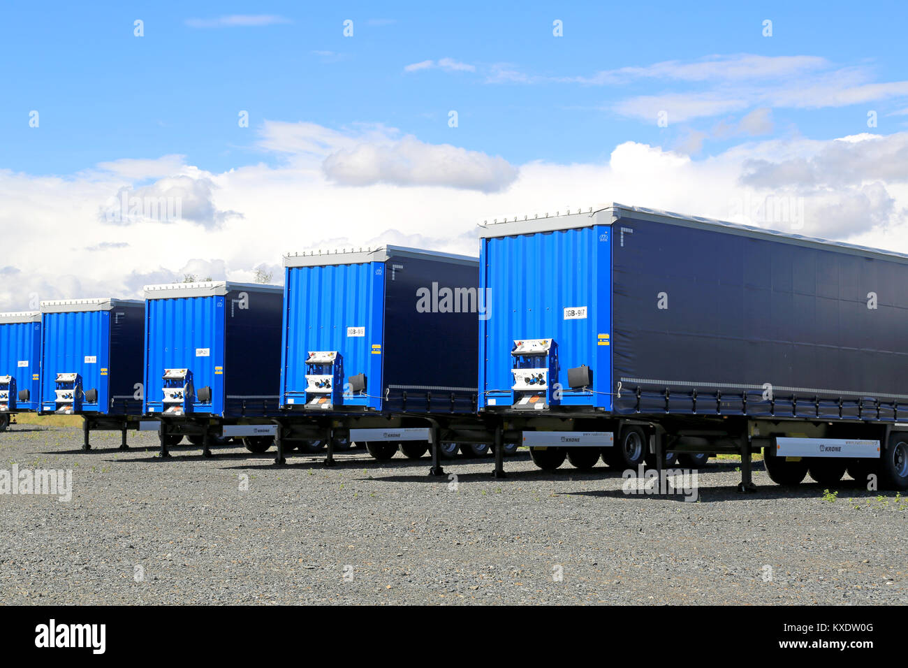 FORSSA, FINLAND - AUGUST 16, 2014: Row of trailers on a yard. The top 5 export destinations of Finland are Sweden, - Stock Image