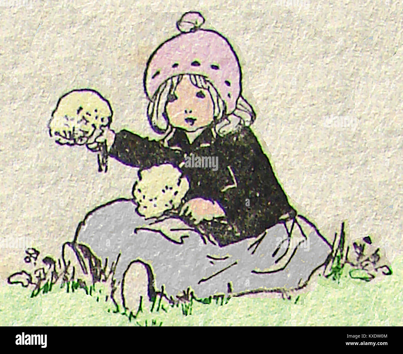 Children at play - a girl sitting in the grass picking flowers - Stock Image