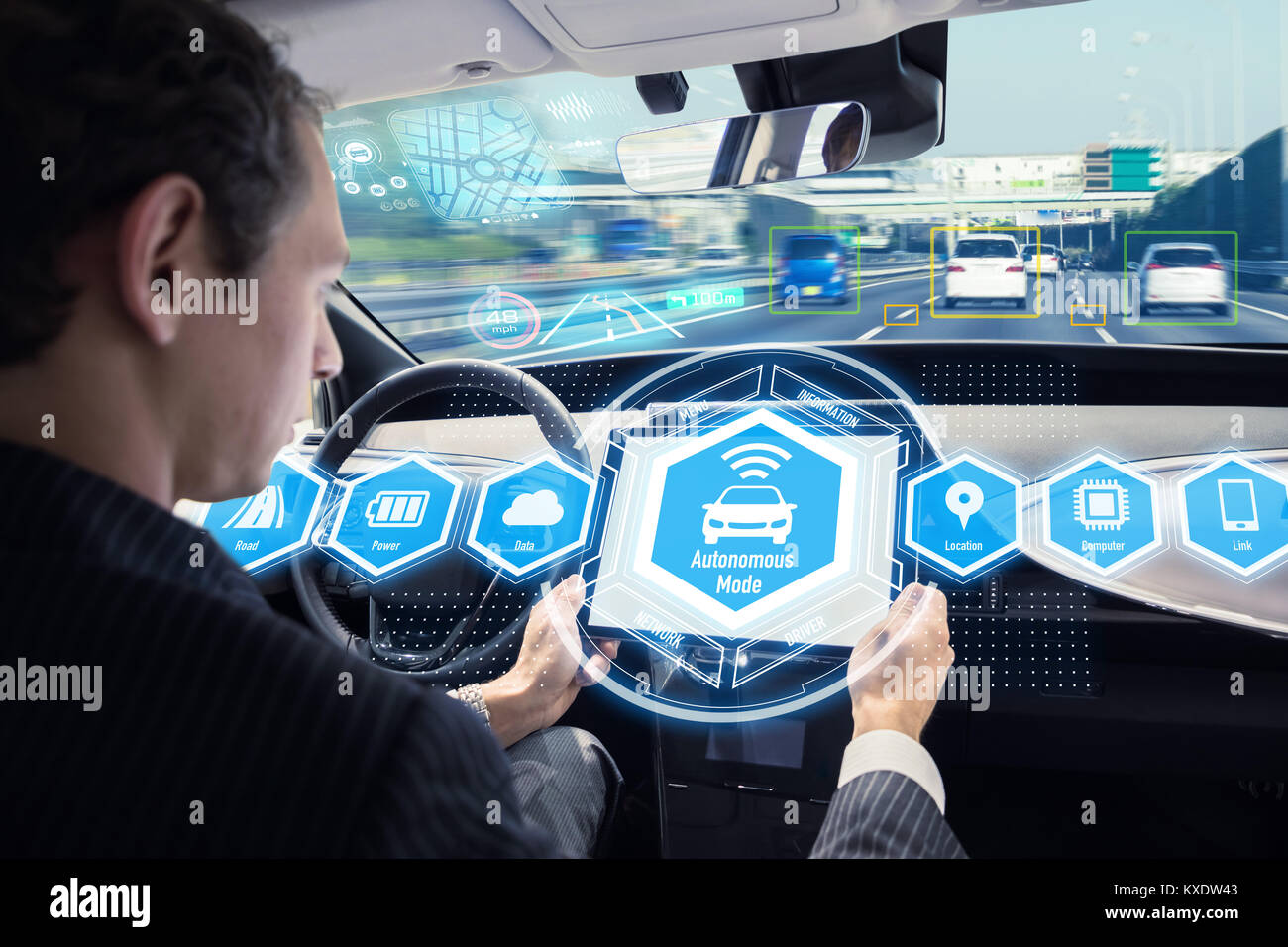 Caucasian man riding autonomous car. Self driving vehicle. Driverless car. - Stock Image