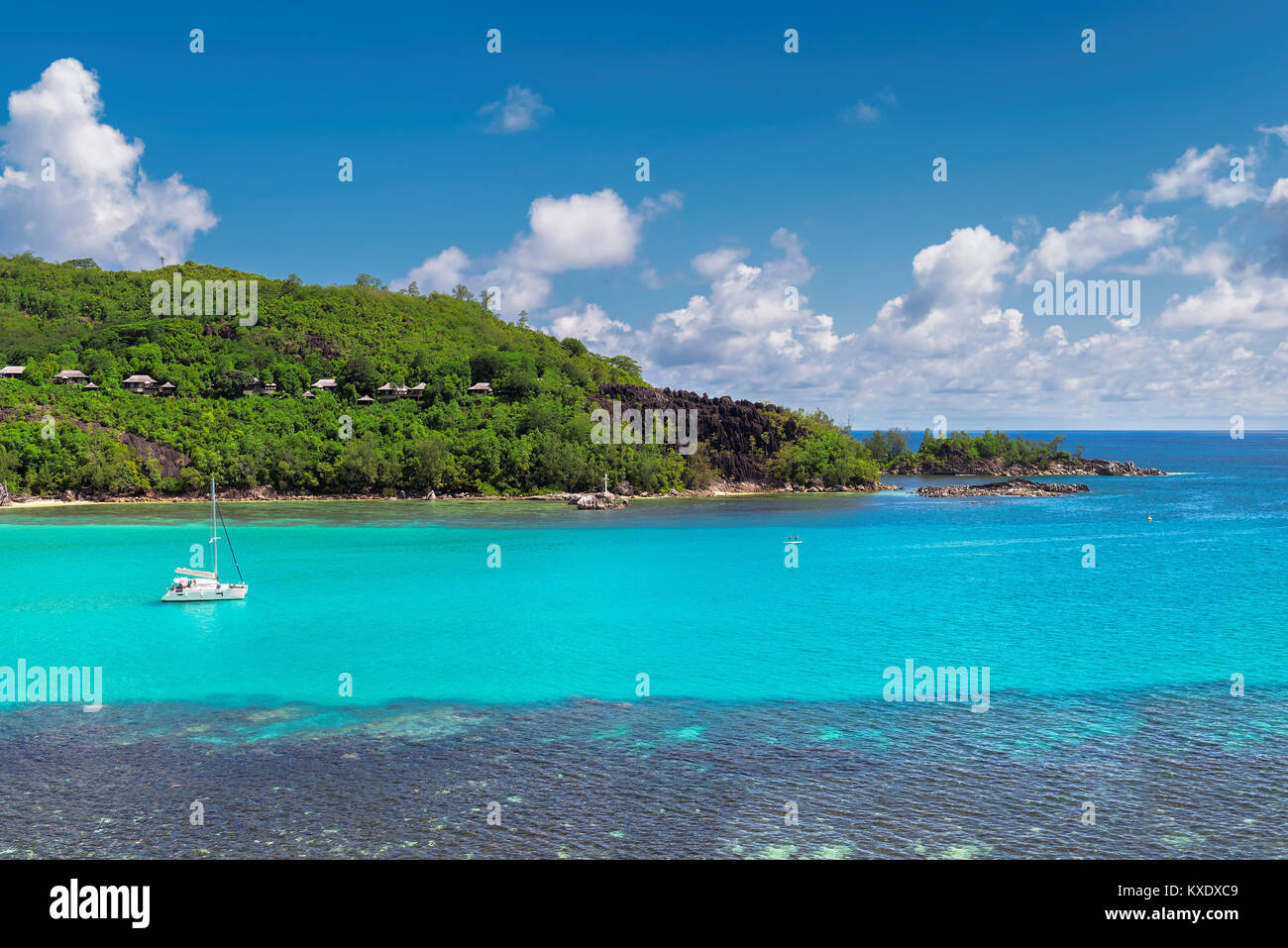 Sailboats in a beautiful bay in Seychelles. - Stock Image