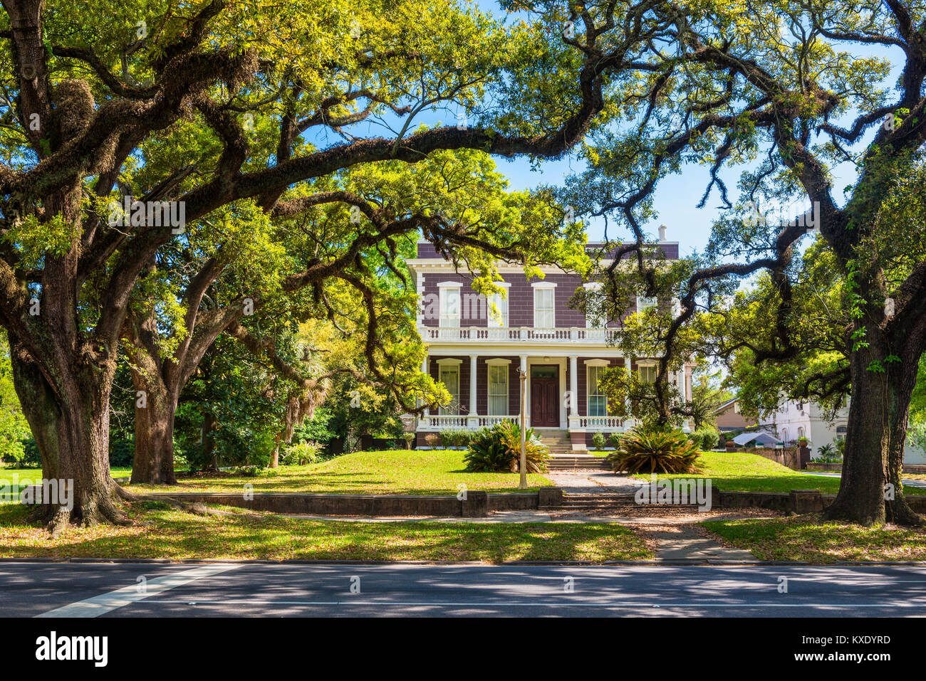 Typical old house with columns in downtown district of Mobile, Alabama, USA - Stock Image