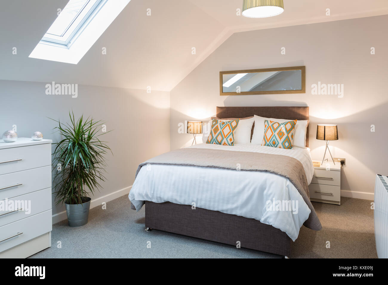 Picture of: Master Bedroom With Large Comfortable Double Bed And Bedside Cabinets Stock Photo Alamy