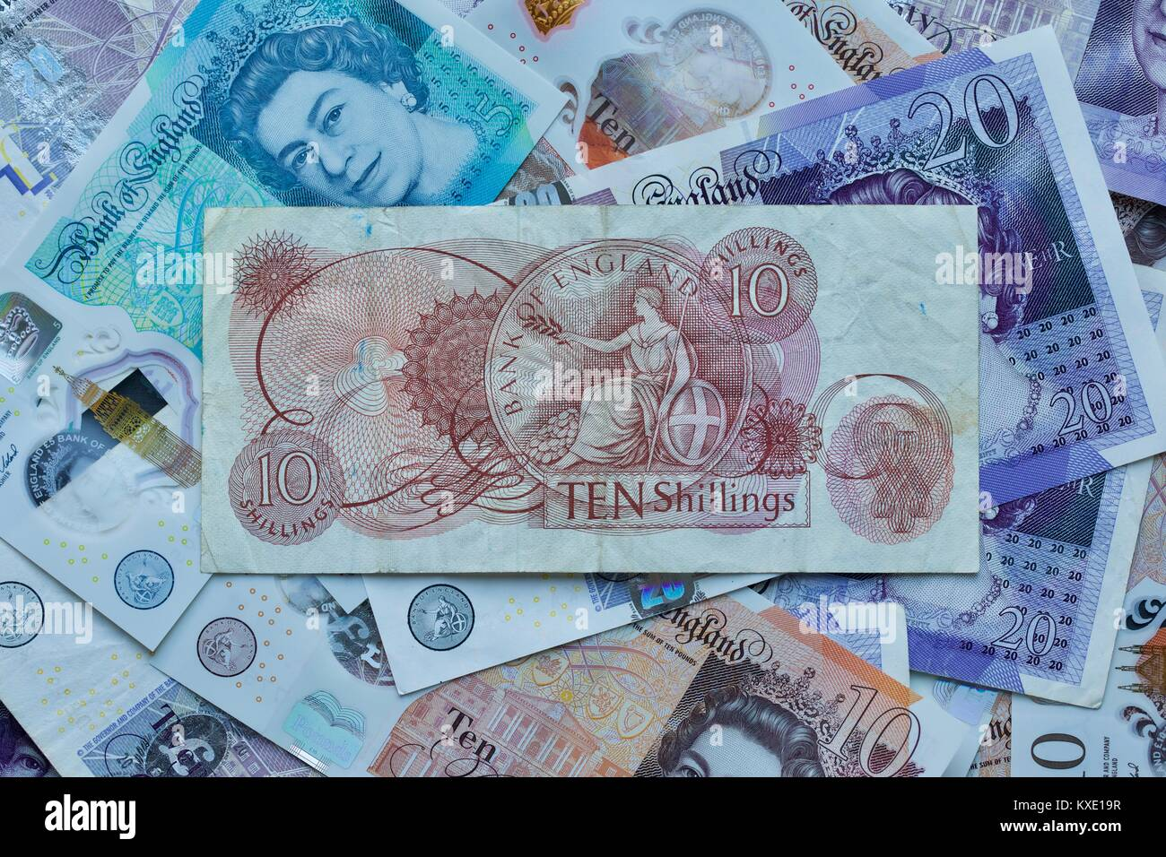 Bank of England 10 Shilling Banknote with the polymer bank notes in the background - Stock Image