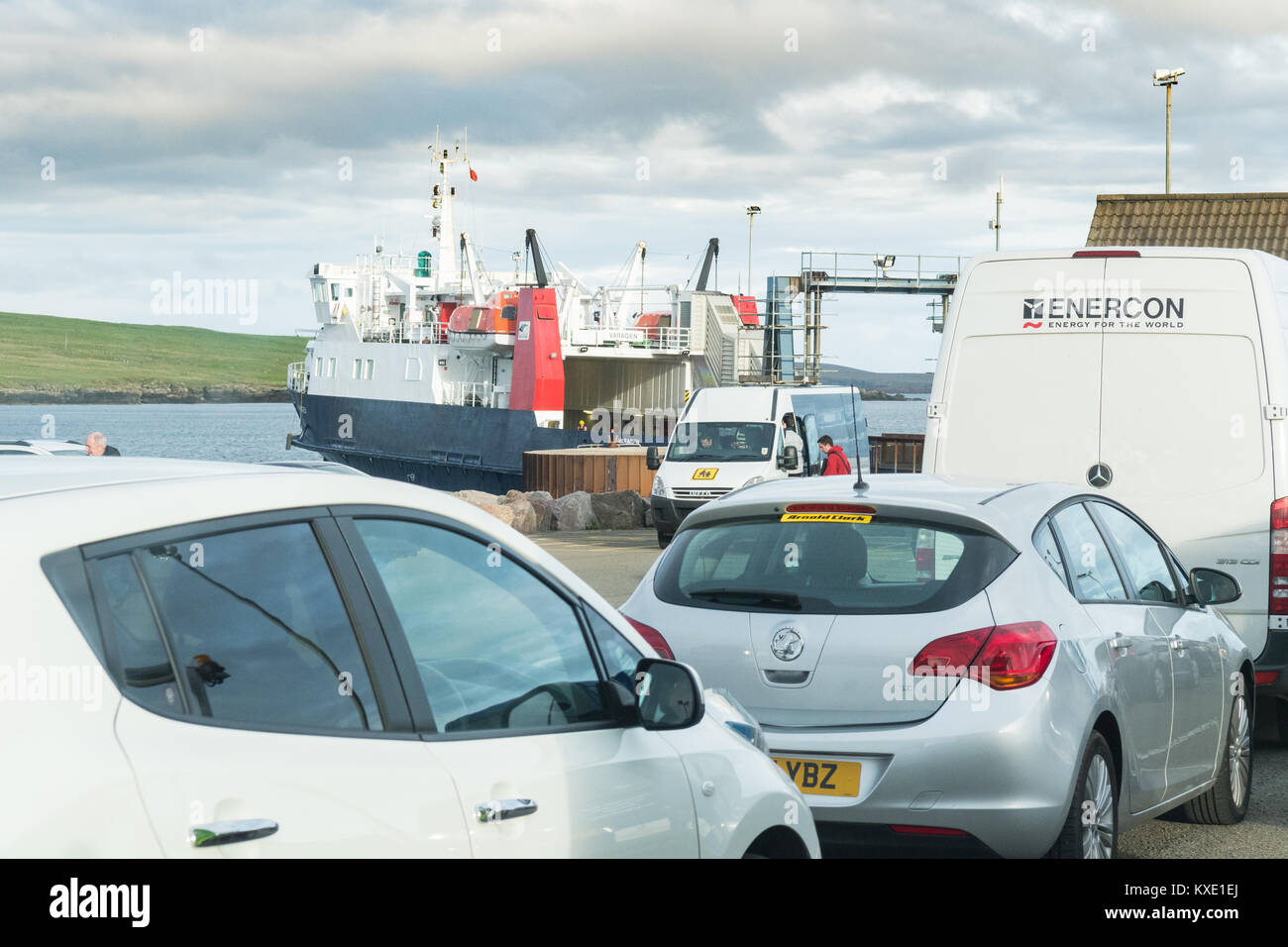 minibus at Rapness Ferry Terminal, on the island of Westray meeting passengers arriving by ferry from Kirkwall, - Stock Image