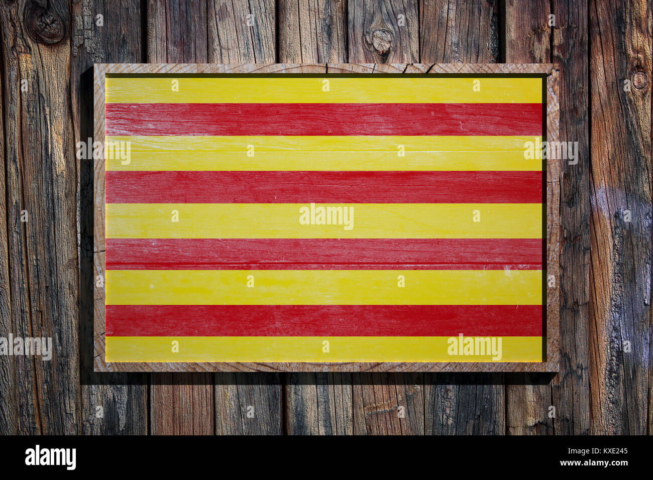 3d rendering of a Catalonia flag on a wooden frame and a wood wall ...