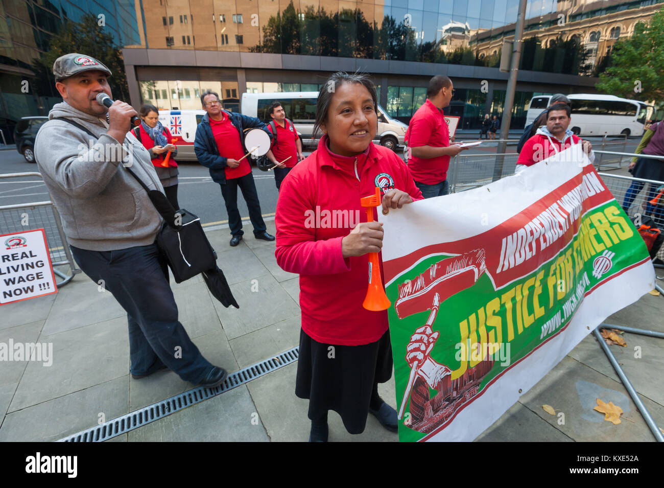 IWGB General Secretary Alberto Durango speaks as the protest for the living wage for Mitie-employed cleaners at - Stock Image