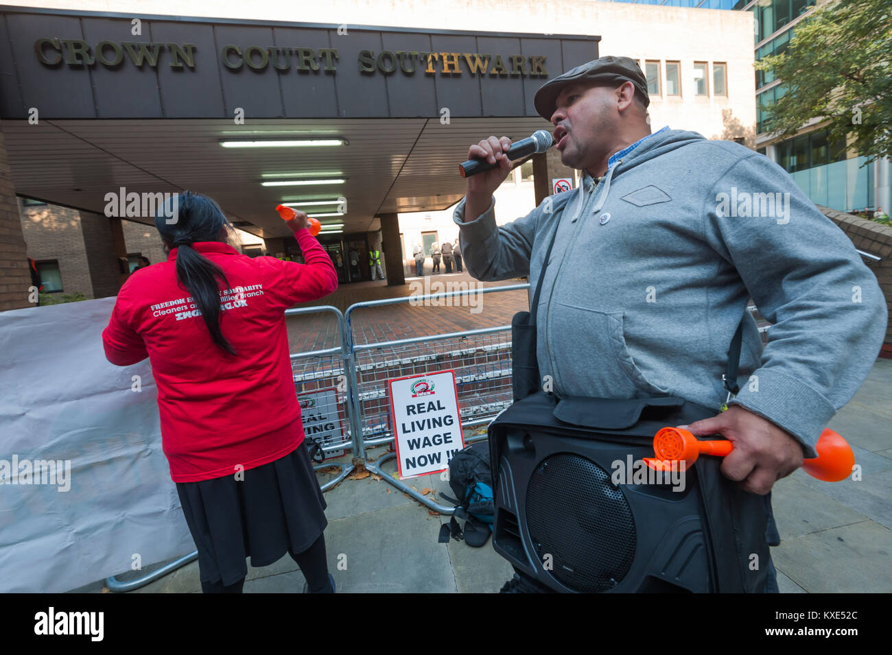 IWGB General Secretary Alberto Durango speaks outside Southwark Crown Court as the protest for the living wage for - Stock Image