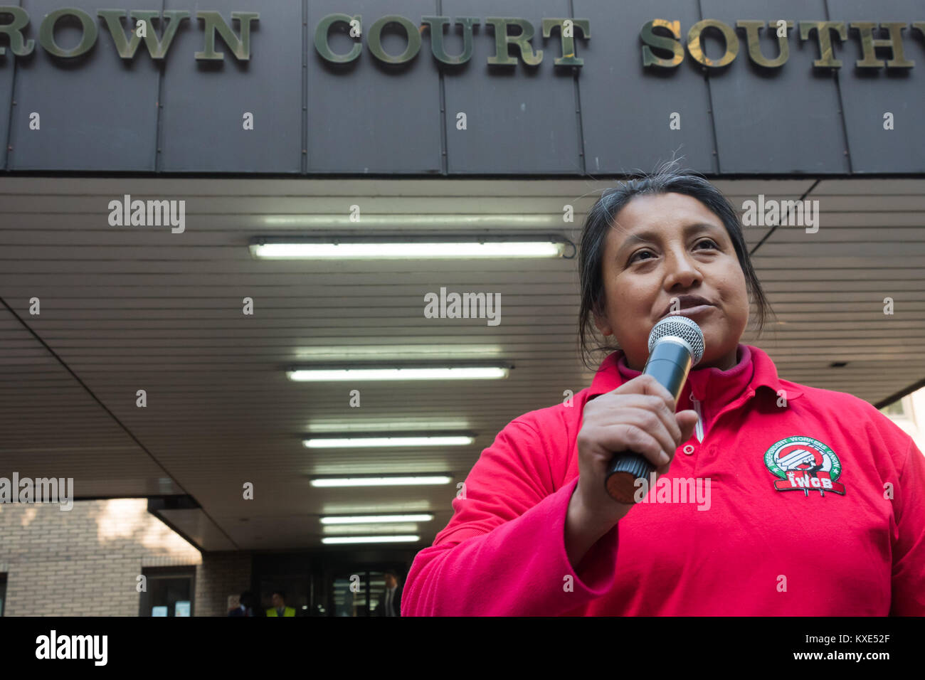 One of the cleaners at Southwark Crown Court speaks at the  IWGB protest for the living wage and an end to management - Stock Image