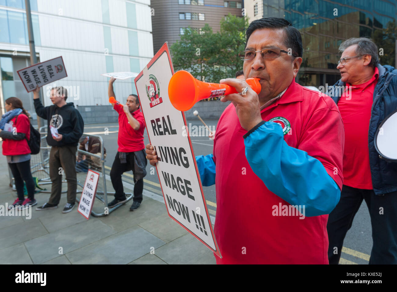 Cleaners make a lot of noise and call for the London Living Wage at the IWGB protest  for Mitie-employed cleaners - Stock Image