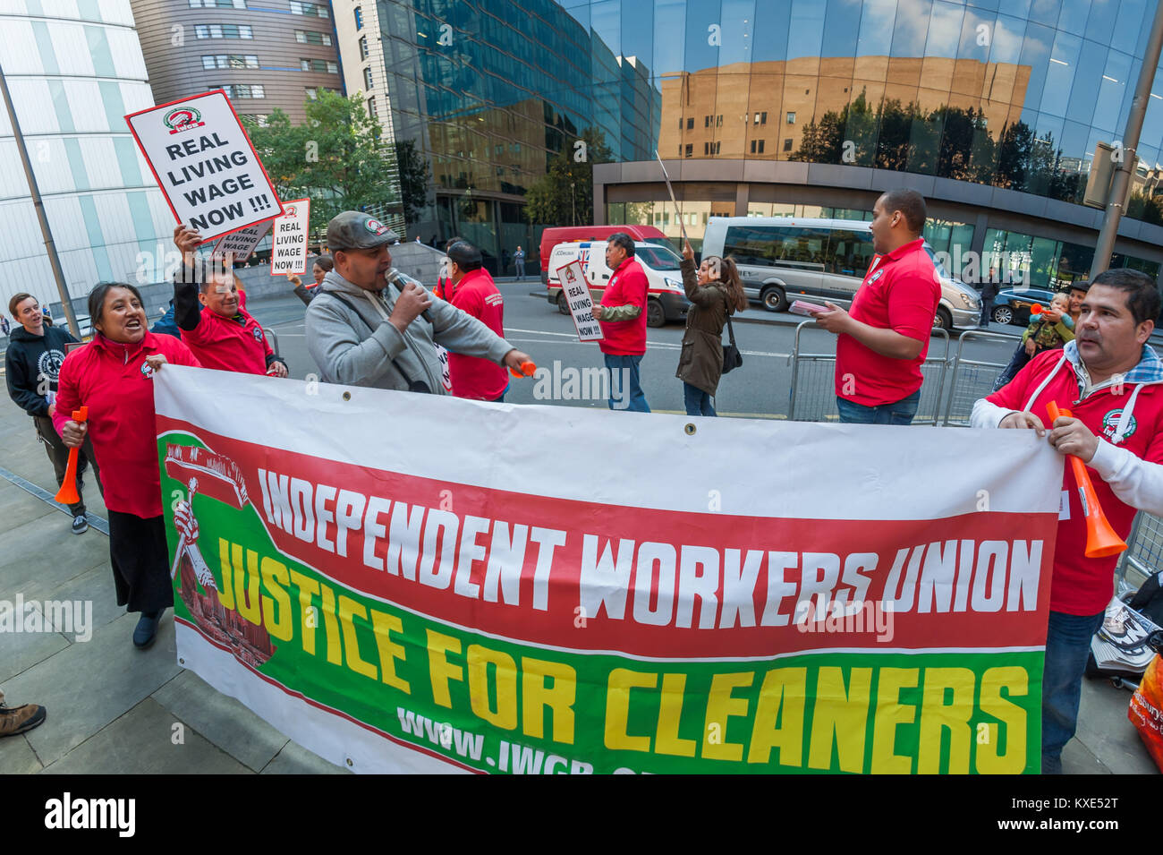 A noisy IWGB protest outside Southwark Crown Court  for the London living wage and an an end to management bullying - Stock Image