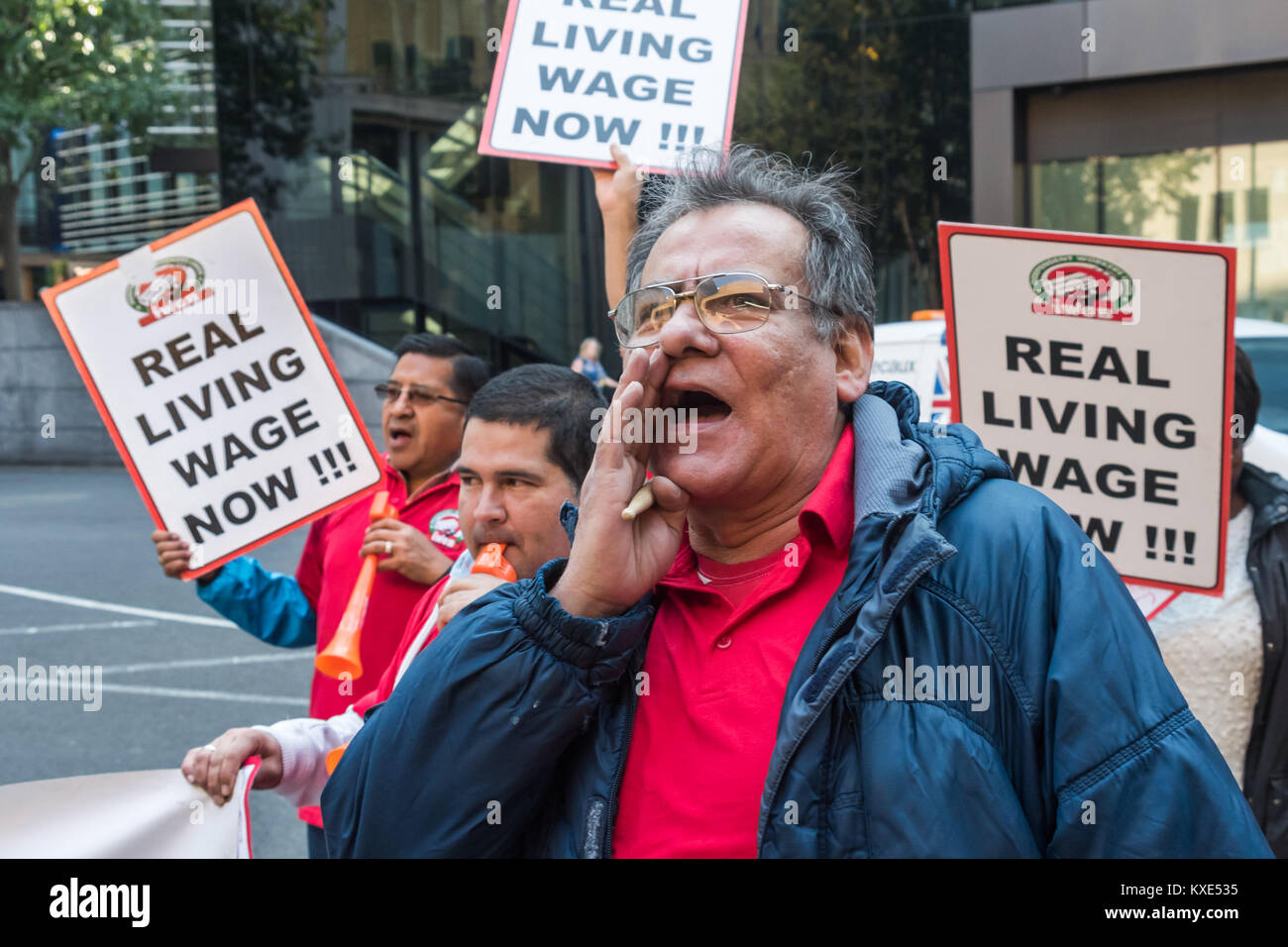 IWGB protesters had a new slogan for their protest for the London living wage for Mitie-employed cleaners at Southwark - Stock Image